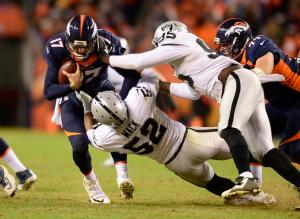 DENVER, CO - DECEMBER 13: Denver Broncos quarterback Brock Osweiler (17) gets sacked by Oakland Raiders defensive end Khalil Mack (52) with help from Oakland Raiders defensive end Benson Mayowa (95) during the fourth quarter December 13, 2015 at Sports Authority Field at Mile High Stadium. (Photo By Eric Lutzens/The Denver Post)